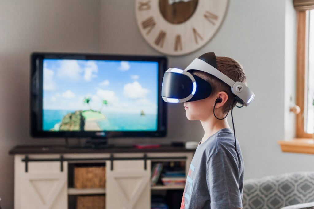 boy using virtual reality goggles 3391378
