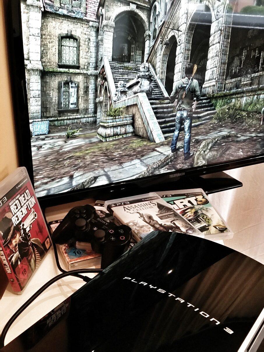 Spielkonsole Playstation 3 mit Spielen